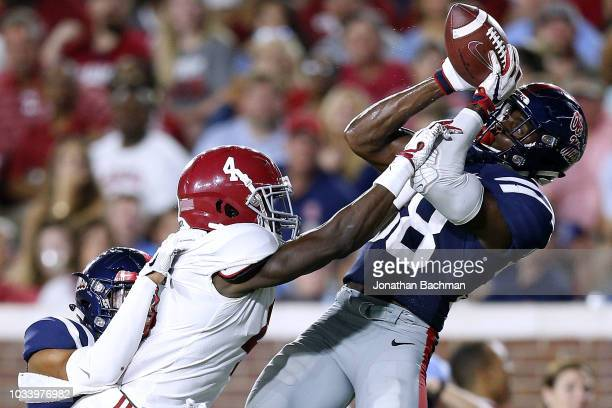 Moore of the Mississippi Rebels intercepts the ball over Jerry Jeudy of the Alabama Crimson Tide during the second half of a game at Vaught-Hemingway...