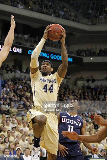 Moore of the Pittsburgh Panthers handles the ball against the Connecticut Huskies at Petersen Events Center on January 19, 2013 in Pittsburgh,...