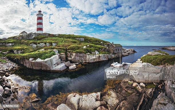 moored at the lighthouse - atlantic ocean stock pictures, royalty-free photos & images