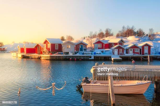 moored boat and snow on the jetty - sweden stock pictures, royalty-free photos & images