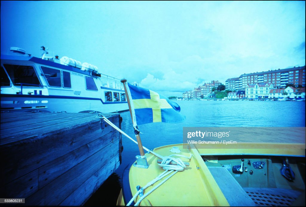 Moored Boat With Flag : Foto stock