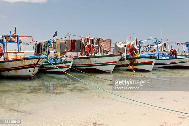 moored boats on beach - djerba stock pictures, royalty-free photos & images