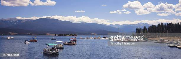 moored boats on mountain lake. - timothy hearsum stock photos and pictures