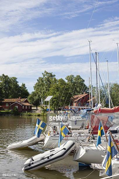 Moored boats with Swedish flags