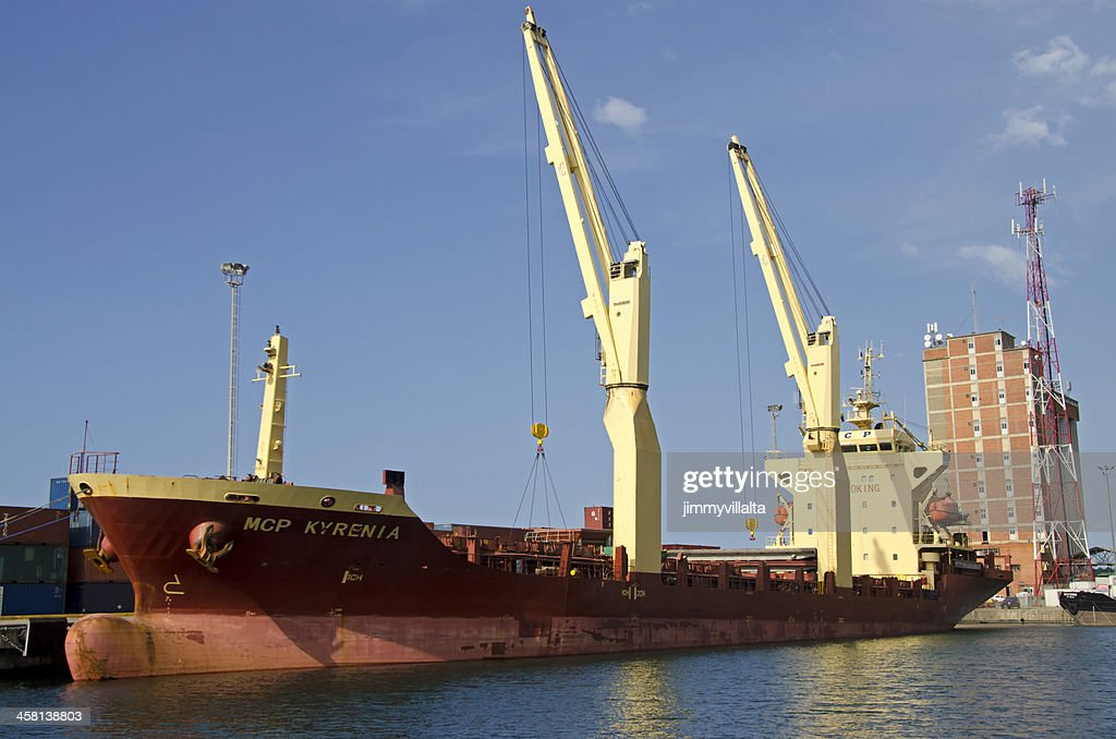 Moored container ship in a harbor : Stock Photo