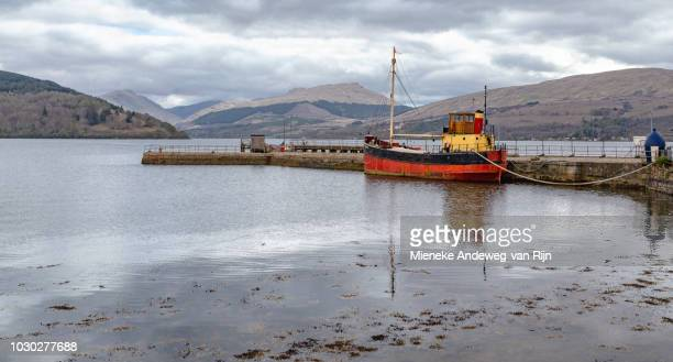 Moored fishing boat at Loch Fyne Pier, Inveraray, Argyll and Bute, Scotland, United Kingdom.
