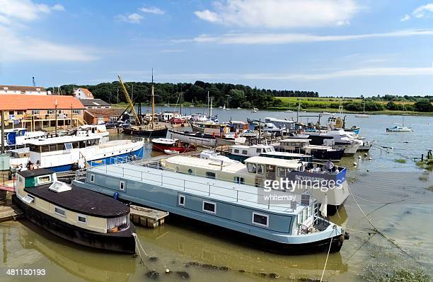 moored houseboats at woodbridge - suffolk england stock photos and pictures