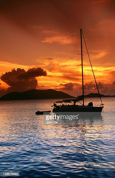 moored yacht at sunset. - cane garden bay stock pictures, royalty-free photos & images