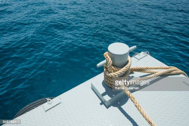 a mooring bollard entwined with a mooring rope - moored stock pictures, royalty-free photos & images