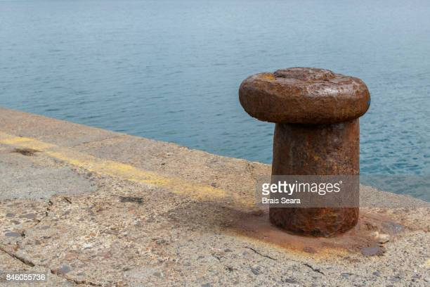 mooring bollards - bollard stock photos and pictures