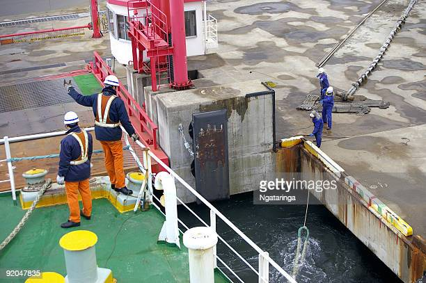 mooring of ferry - crew stock pictures, royalty-free photos & images