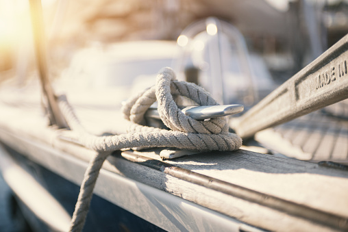 Mooring rope and bollard at the touristic harbor: vacations and yatching concept 1126381112