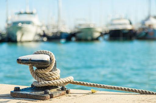 Mooring rope on sea water background 594020968