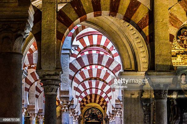 Moorish style arches within the Mezquita in Cordoba, Spain