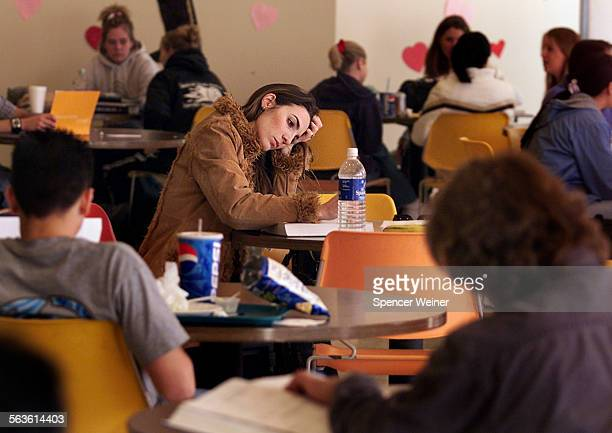 Moorpark College student Veronica Arbuckle of Simi Valley studies in the college's lunchroom Monday Feb 10 2003 Enrollment at community college's in...