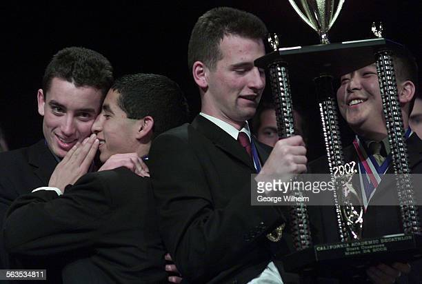 3/24/2002 – Moorpark High academic decathlon team members from left Nathaniel Jones Johnny Mendoza Dean Reich and Jerome Yang embrace and celebrate...