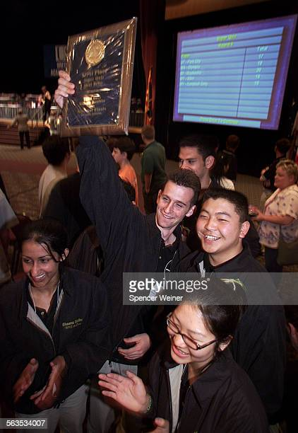 Moorpark High School students celebrate a victory Friday during US Academic Decathlon in Phoenix Sheena Sidhu Dean Reich holding up plaque won during...