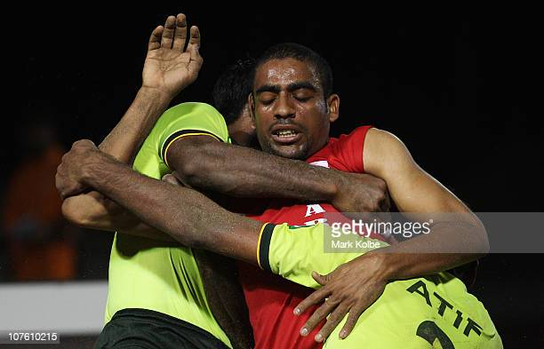 Moosa AlGhazali of Oman is tackled as he competes in the mens semi final match between Pakistan and Oman during Beach Kabaddi event at North Al Hail...