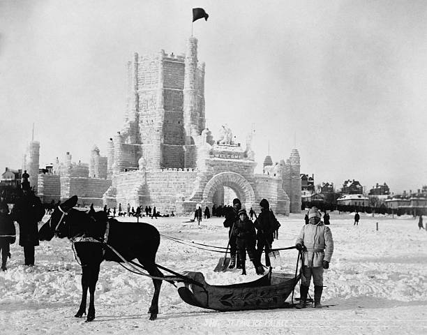 A moosedrawn sleigh stops outside an ice palace at the 1887 St Paul Winter Carnival