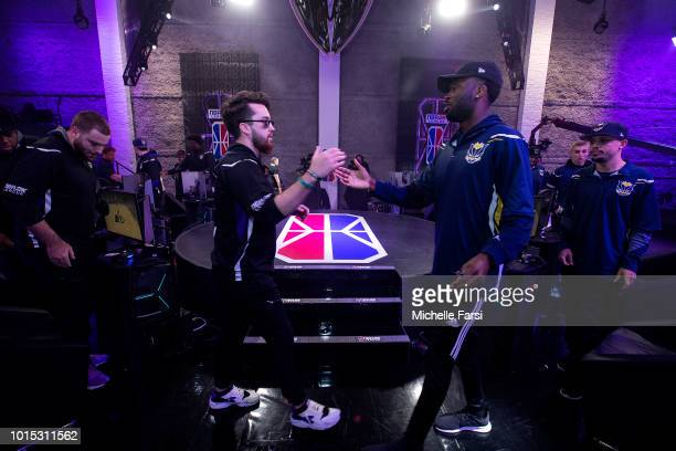 Mooty of the Kings Guard Gaming handshakes Shockey of the Pacers Gaming after the game between the Kings Guard Gaming v Pacers Gaming on August 11...