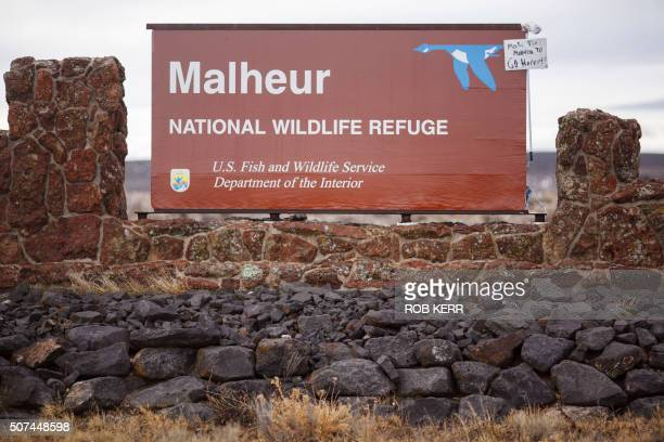 A mop and sign are taped to a sign for the occupied Malheur National Wildlife Refuge near Burns Oregon on January 29 a day after the FBI released...