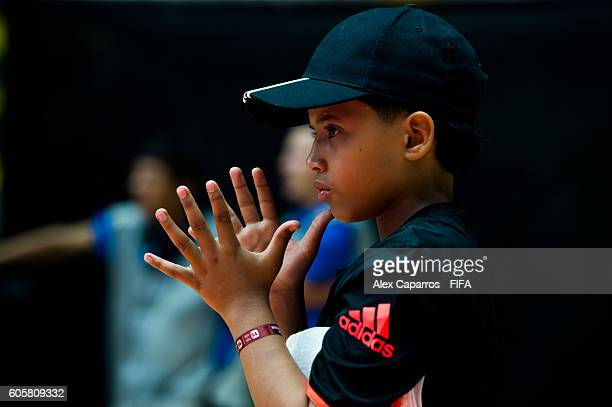 A mop boy looks on during the FIFA Futsal World Cup Group B match between Thailand and Cuba at Coliseo Ivan de Bedout stadium on September 13 2016 in...