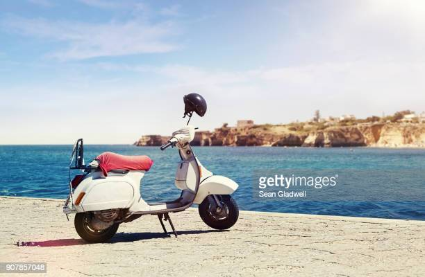 moped by ocean - moped stock photos and pictures
