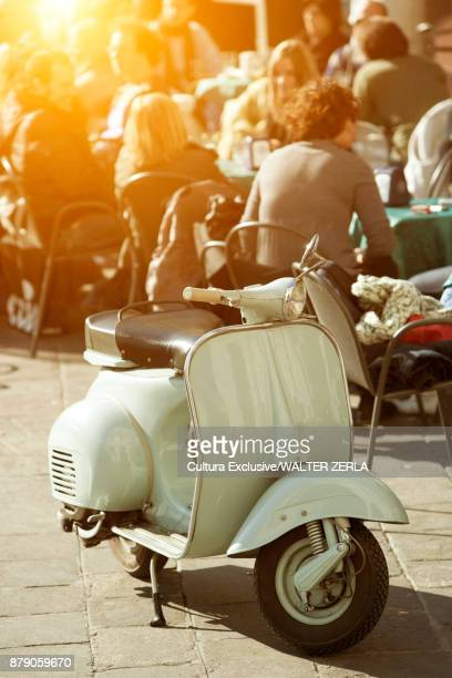 Moped by pavement cafe, Padua, Veneto, Italy, Europe