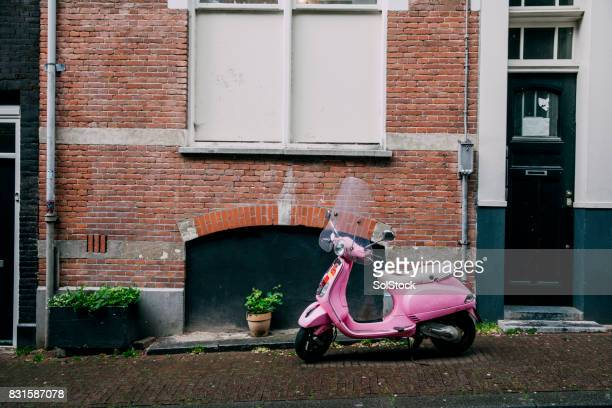 moped parked on european street - moped stock photos and pictures