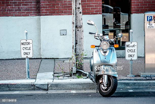 moped parked on the street - moped stock photos and pictures