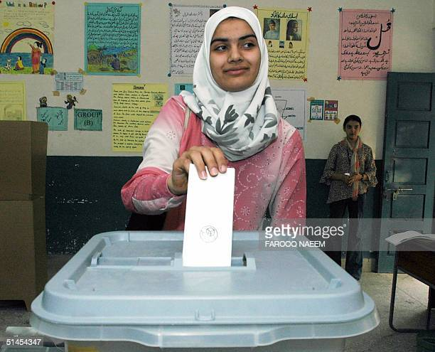 Moqadasa Sidiqi casts her ballot in a refugee camp on the edge of the capital Islamabad 09 October 2004 The first vote in Afghanistan's landmark...