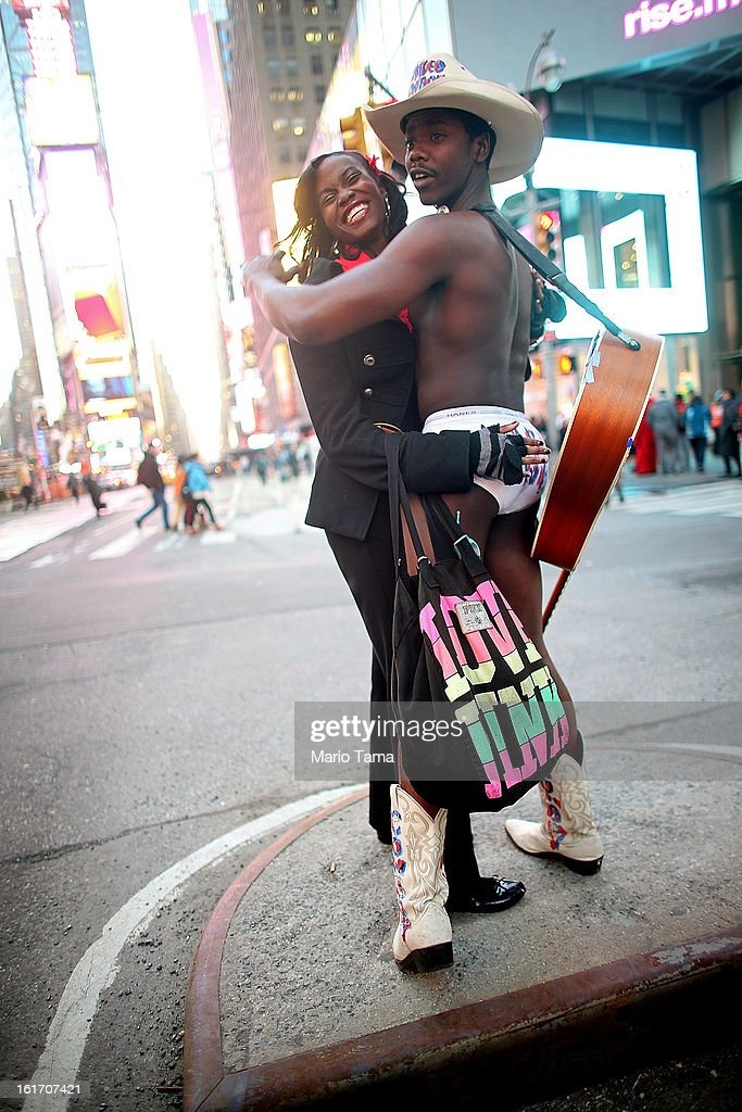 Mora Giwa (L) poses with performer Titus Gandy in Times Square during Valentine's Day celebrations on February 14, 2013 in New York City. People around the world are celebrating the lovers holiday.