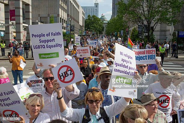 Moral Monday demonstrators head toward the General Assembly from the Bicentennial Mall after gathering and calling for the repeal of HB2 in Raleigh...
