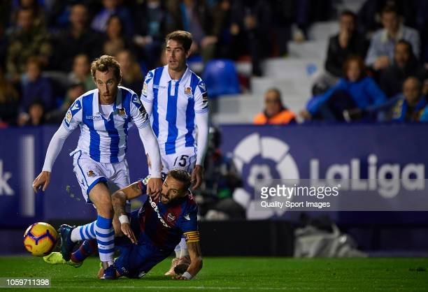 Morales of Levante competes for the ball with David Zurutuza and Aritz Elustondo of Real Sociedad during the La Liga match between Levante UD and...