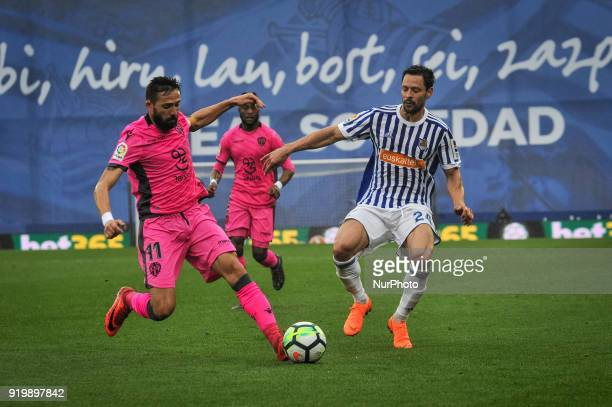 Morales of Levante duels for the ball with De la Bella of Real Sociedad during the Spanish league football match between Real Sociedad and Levante at...
