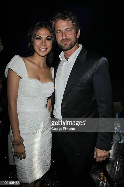 Moran Atias and actor Gerard Butler attend the Artists for Peace and Justice Fundraiser at the VIP Room, Palm Beach during the 63rd Annual...