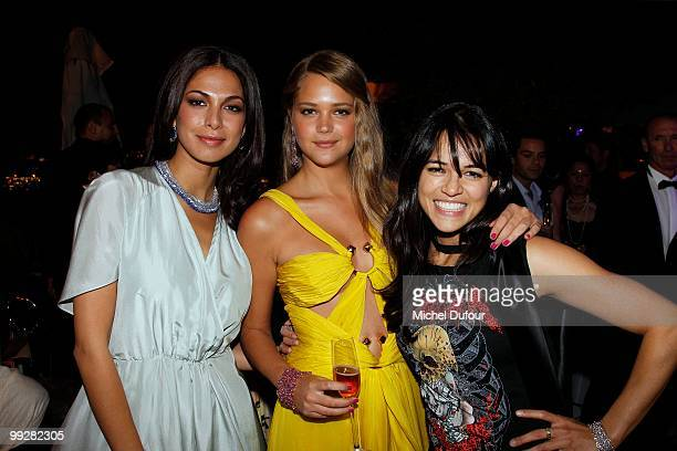 Moran Atias Esti Ginsburg and Michelle Rodriguez attends the Chopard Trophy party at the Hotel Martinez during the 63rd Annual Cannes Film Festival...