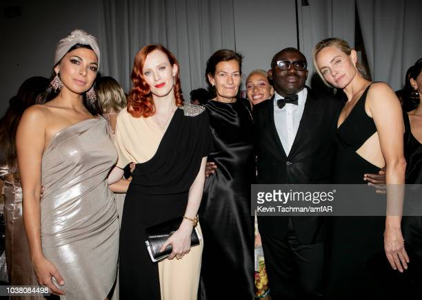 Moran Atias Karen Elson Adwoa Aboah Edward Enninful and Amber Valetta are seen during the cocktail reception of amfAR Gala at La Permanente on...