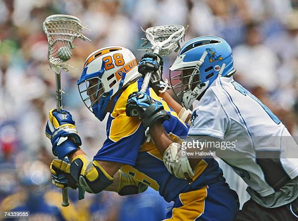 J Moran of the University of Delaware gets checked from behind by midfielder Austin Walker of Johns Hopkins University at MT Bank Stadium May 26 2007...