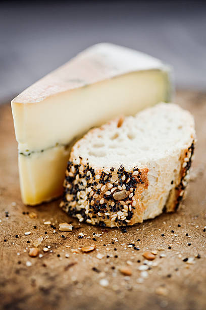 Morbier Cheese On A Board With Seeded Bread. Wall Art