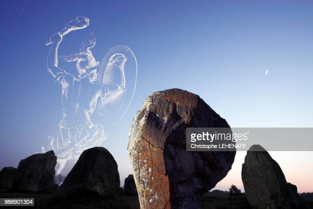 morbihan, carnac, menhirs, alignment of kermario in the twilight. the orion hunter seems to want to capture the crescent of the moon. - mythology stock pictures, royalty-free photos & images