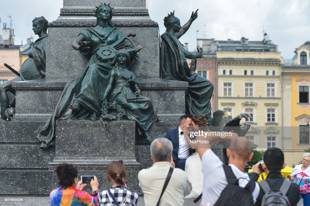More and more newly weds from Krakow, Poland and around the world have their wedding pictures taken in Krakow's Main Market Square and around the Old Town, as Krakow becomes a preferred destination of Love and Romance. On Tuesday, August 22, 2017, in Krakow, Poland.