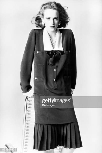 More fitted skirts emphasised shoulders belted jackets and new and varied collars some of the features in the Autumn and Winter 1983 Collection from...