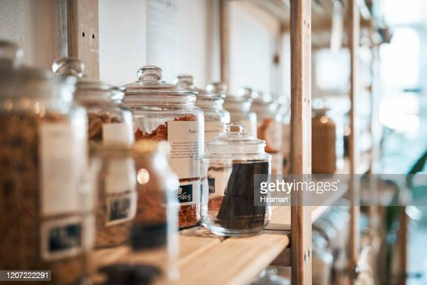 more glass, less plastic pollution - health food shop stock pictures, royalty-free photos & images