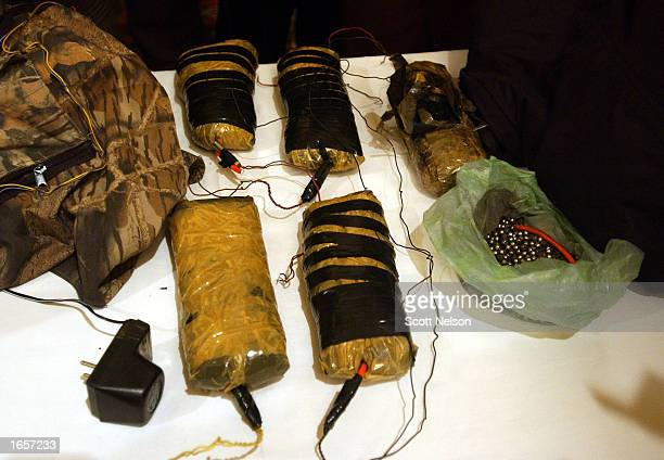 More than 10 kilos of C4 plastic explosives and shrapnel rigged for a suicide vest are displayed by Afghan authorities November 23 2002 in Kabul...