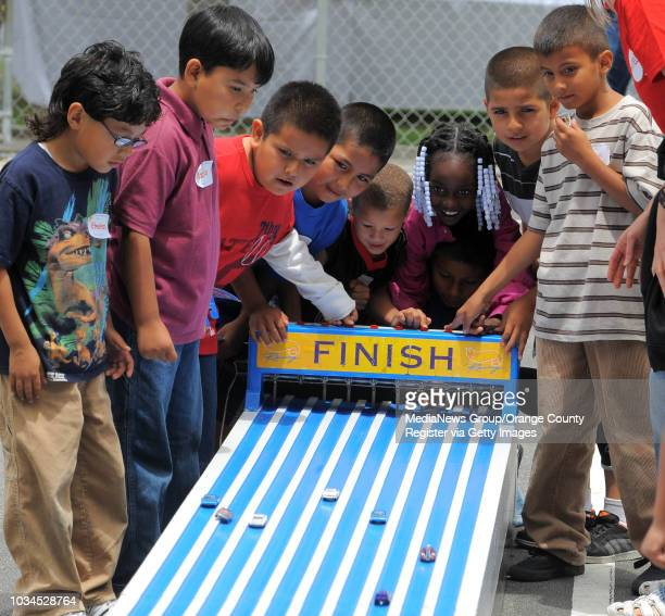 Scott Varley More than 100 students from 112th Street Elementary School in Watts were treated to lunch fun and games Thursday at the Mattel...