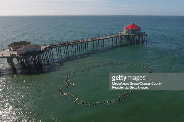 More than 100 surfers took to the ocean north of the Huntington Beach Pier to honor Pierre Agnes CEO of Quiksilver in Huntington Beach on Friday Mar...