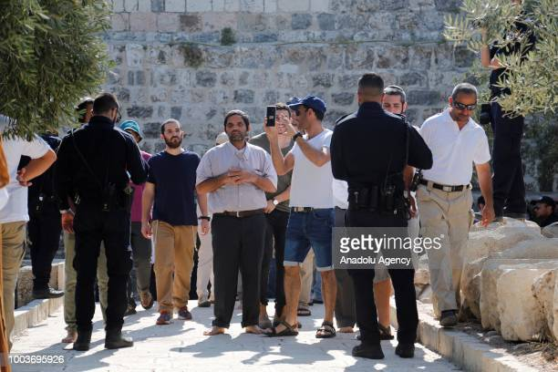 More than 1,000 Israeli settlers including children are their way into East Jerusalems flashpoint Al-Aqsa Mosque compound backed by Israeli police...