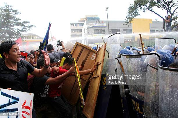 More than 1,000 multi-sectoral groups clash with the members of Philippine National Police Civil Disturbance Management in Buendia Avenue in Pasay...