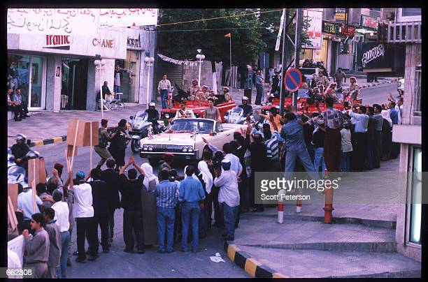 More than 10000 Jordanians gather to cheer their monarch King Abdallah II and his wife Queen Rania as they pass in a motorcade on the street June 8...